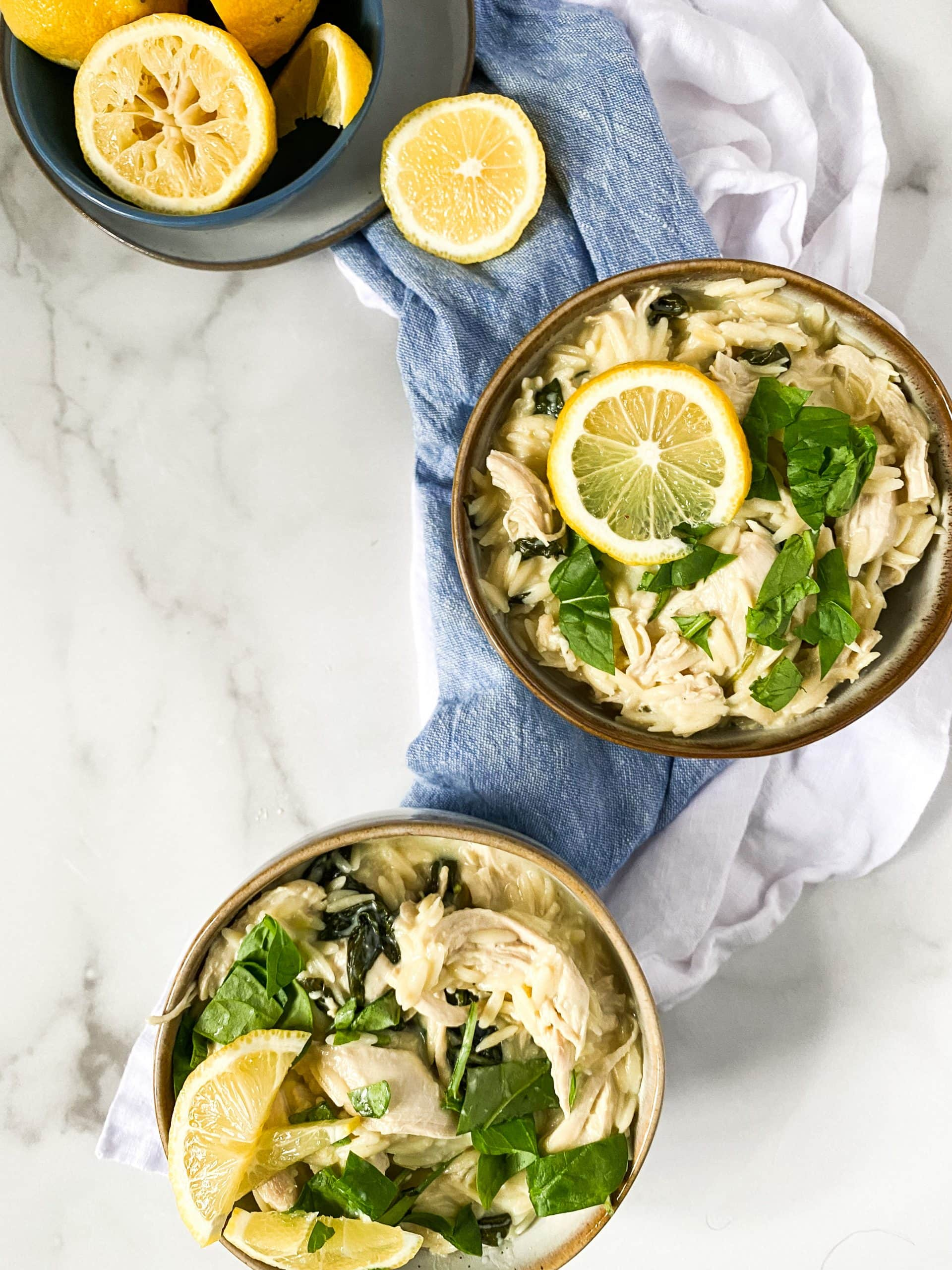 dairy free lemon orzo soup in 2 bowls