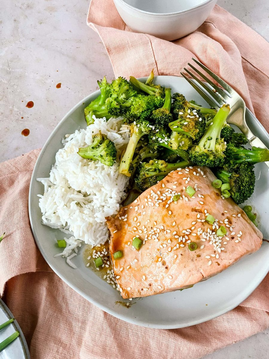 Plated salmon teriyaki with roasted broccoli and rice