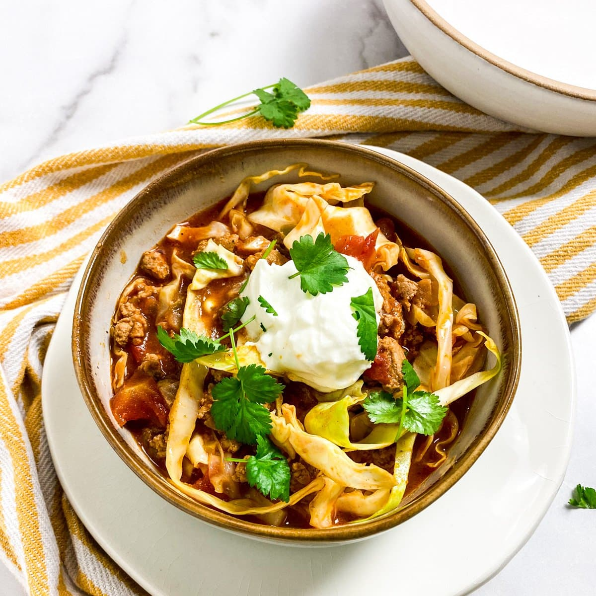cabbage soup in a bowl with greek yogurt